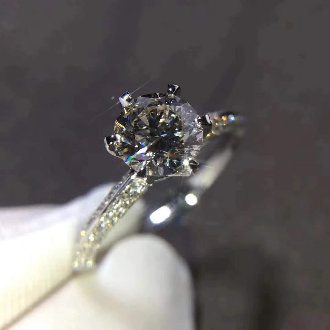 INSPIRED THE TIFFANY SETTING ENGAGEMENT RING WITH PAVÉ DIAMOND BAND IN PLATINUM