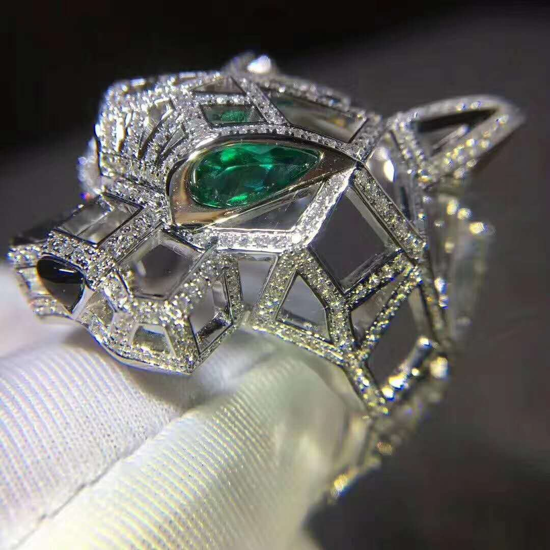 Panthère de Cartier Ring in 18K White Gold set with 545 Brilliant-cut Diamonds, Emeralds and Onyx